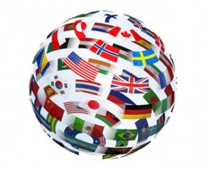 A Graphic depicting the global economy in the form of a sphere with flags of each country in 3 D