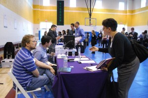 Word Wizards Inc talking to a potential new employee at the WIFV job fair
