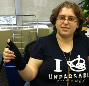 Valery gives a thumbs up while wearing transcription gloves.