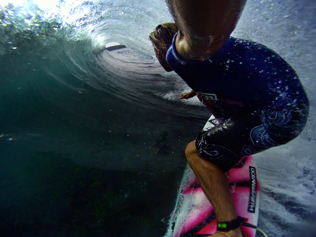 Surfer Byron Bartlett goes deep in the tube of a beatufifull wave, captured using a GoPro sports video camera.