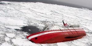 A Ship overturned sinking in the arctic.