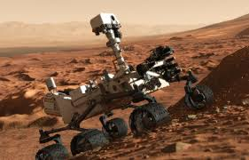 Mars Rover Curiosity exploring the rocky surface of Mars.
