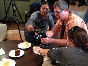 Participants in the 48 hour film project preparing a scene for their shoot.